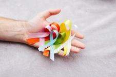 Hand holding cancer awareness ribbon
